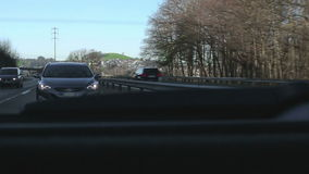The car goes on the road to the peas. View from the back window of the car stock footage