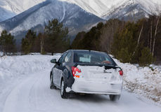 Car goes on the snow-covered road in Trans-Baikal National Park. Stock Photo
