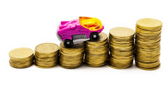 The car goes up after coins Stock Photos