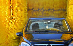 Car going through an automated car wash machine Royalty Free Stock Photography