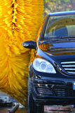 Car going through an automated car wash machine Stock Images