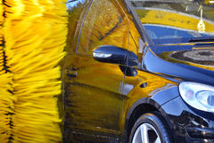 Car going through an automated car wash machine Stock Photography