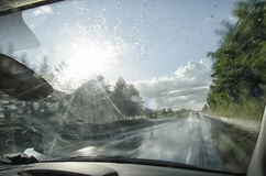 Car going fast on a wet motorway. View of car going fast on a wet motorway Stock Images