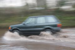 Car Going Through Flood Stock Image