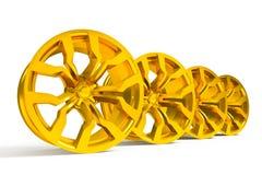 Car gold alloy wheel isolated over white. Set of car gold wheels isolated over white - 3d render Royalty Free Stock Photo