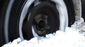 Car got stuck in the deep snow. Wheel of a car turns and slips in the deep snow in winter stock video