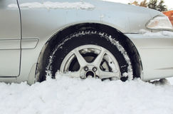 The car got stuck in the snow. In the winter stock photos