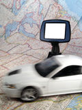 Car with GPS. White Car in Motion on USA Map with GPS unit in Background Stock Image