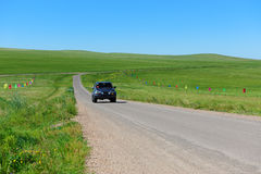 Car in grassland Royalty Free Stock Photo