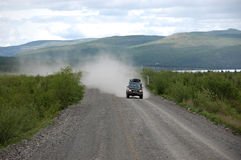 Car at gravel road Kolyma highway at Russian outback Stock Photography