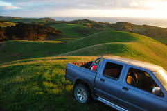 Car at green hill top rural area Royalty Free Stock Image