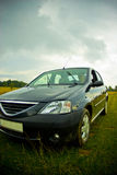Car in green meadow Stock Photos