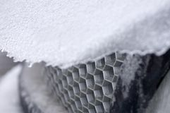 Car Grill. A sheet of ice sliding down an engine hood, the car grill in focus Stock Photo