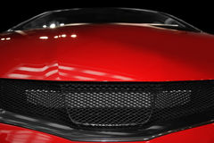 Car grill. Close-up of red car stock photo