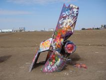Car gronded Cadillac Ranch in Texas royalty free stock photography