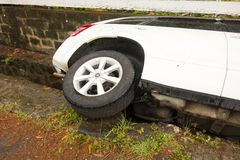 A car in the gutter after a party in the caribbean Royalty Free Stock Photography