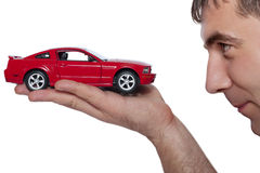 Car in the hand. A hand holding the model of a car. symbol photo for car purchase stock photo