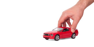 Car in the hand. A hand holding the model of a car symbol photo for car purchase stock photo