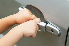 Car handle and a child Stock Images