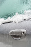 Car handle is covered with ice after freezing rain. Stock Image