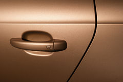 Car handle. Of vehicle door, detail of bronze metallic bodywork, sport powerful sedan Stock Photography