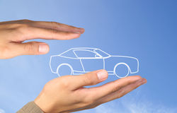 Car in hands. On blue sky Royalty Free Stock Photography