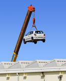 Car Hanging by the Arm of a Crane Royalty Free Stock Photo