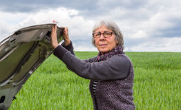 Car has breakdown Senior Woman hood opens Royalty Free Stock Photo