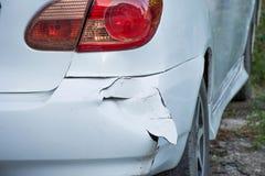 Car has a dented rear bumper. A car has a dented rear bumper Stock Image