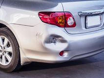 Car has dented rear bumper damaged. After accident Royalty Free Stock Images