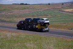 Car Hauler / Yellow and Blue Semi.  Royalty Free Stock Images