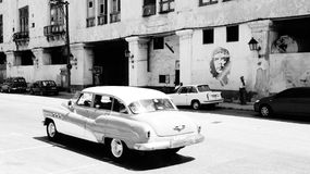 Car in Havana, Cuba and Che Guevara. Two symbols of Cuba: the American car and a portrait of Che Guevara Stock Photo