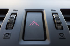 Car hazard button. Close-up. Can be used to convey the danger concept stock images