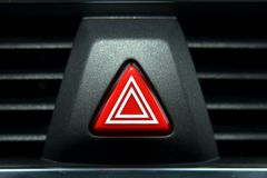 Car hazard lights switch. A switch for the hazard lights in the car royalty free stock image