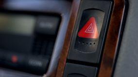 Car hazard warning flasher button on dashboard, emergency situations threat. Stock photo royalty free stock image
