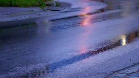 Car head light on wet street stock video footage