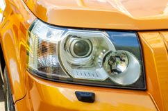 Car head light yellow. In the street stock photo