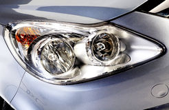 Car head lights in silver Royalty Free Stock Image