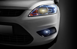 Car Headlight. A view of the headlight of a modern white car Stock Photo