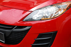Car Headlight. A photo taken on the headlight of a red car Royalty Free Stock Photography