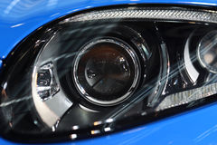 Car Headlight. Of a blue sport car stock photos