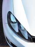 Car headlight. Headlight of a new modern looking car Stock Photography