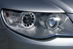 Car headlight. Closeup of silver car headlight Royalty Free Stock Photography