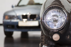 Car headlight in the background of a car. Part of car in the background of a car Stock Image