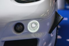 Car headlight with backlight. Exterior detail.White color car - image royalty free stock image