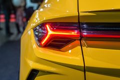 Car headlight with backlight. Exterior detail.Yellow color  luxury car - image royalty free stock photos
