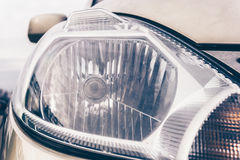 Car headlight, close up of exterior detail of vehicle Royalty Free Stock Images