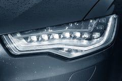 Car headlight in drops Royalty Free Stock Photos