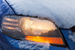 Car headlight flashing under snow Stock Photo
