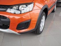 Car headlight and hood of powerful car  orange Royalty Free Stock Photography